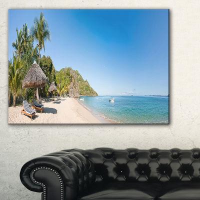 Designart Beach With Chairs And Umbrellas SeashorePhoto Canvas Print - 3 Panels