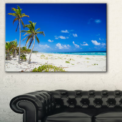 Designart Beautiful Blue Sea With Palms SeashorePhoto Canvas Print