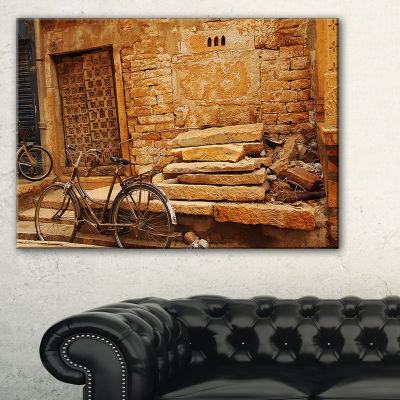 Designart Bicycle Against Brown Wall Landscape Photo Canvas Art Print
