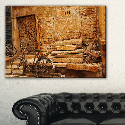 Designart Bicycle Against Brown Wall Landscape Photo Canvas Art Print - 3 Panels