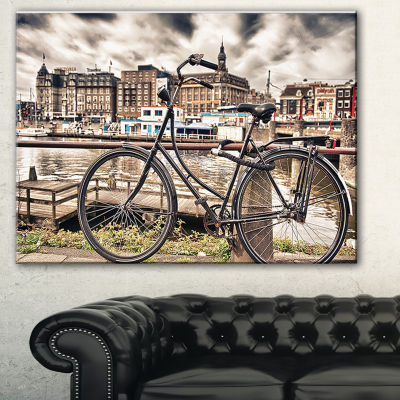 Designart Bike Over Bridge In Amsterdam CityscapePhoto Canvas Print