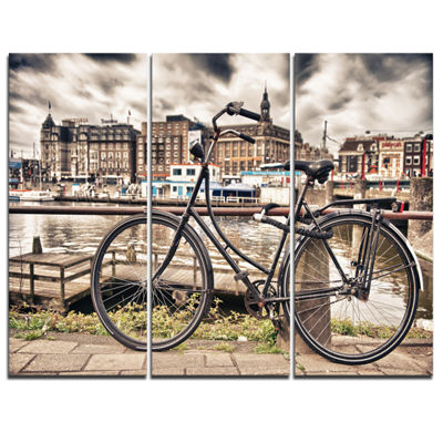 Designart Bike Over Bridge In Amsterdam CityscapePhoto Canvas Print - 3 Panels