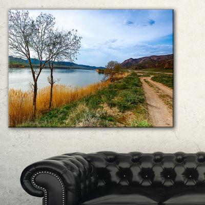 Designart Blue River And Sky In Village LandscapePhoto Canvas Art Print - 3 Panels