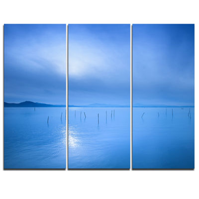 Designart Blue Water Surface In Morning SeascapeCanvas Art Print - 3 Panels