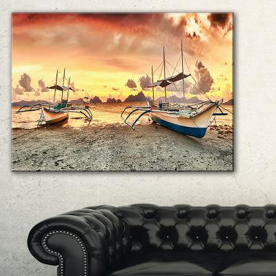 Designart Boats At Sunset Seashore Photography Canvas Art Print - 3 Panels