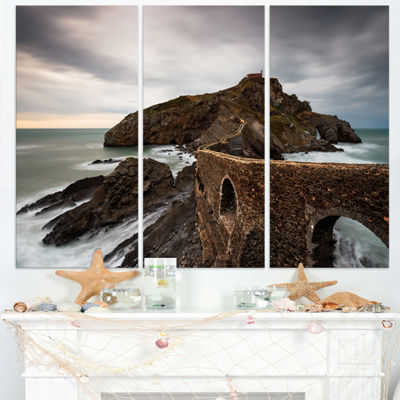 Designart Cape And Chapel In Spanish Beach Seashore Photo Canvas Print - 3 Panels