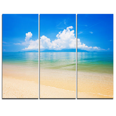 Designart Cloudy Horizon Over Blue Sea Seashore Photo Canvas Art Print - 3 Panels