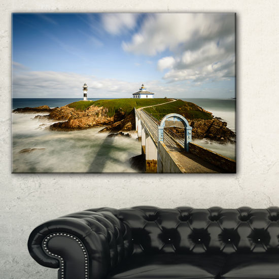 Designart Cloudy Illa Pancha Lighthouse SeashorePhoto Canvas Print