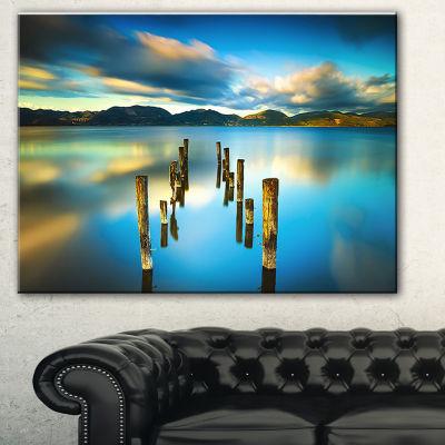 Designart Cloudy Lake With Broken Pier Seascape Canvas Art Print - 3 Panels