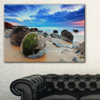 Designart Cloudy Sunrise Over Moeraki Boulders Seashore Photo Canvas Print