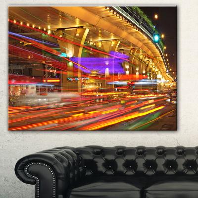 Designart Colorful Traffic Trails In City Cityscape Photo Canvas Print