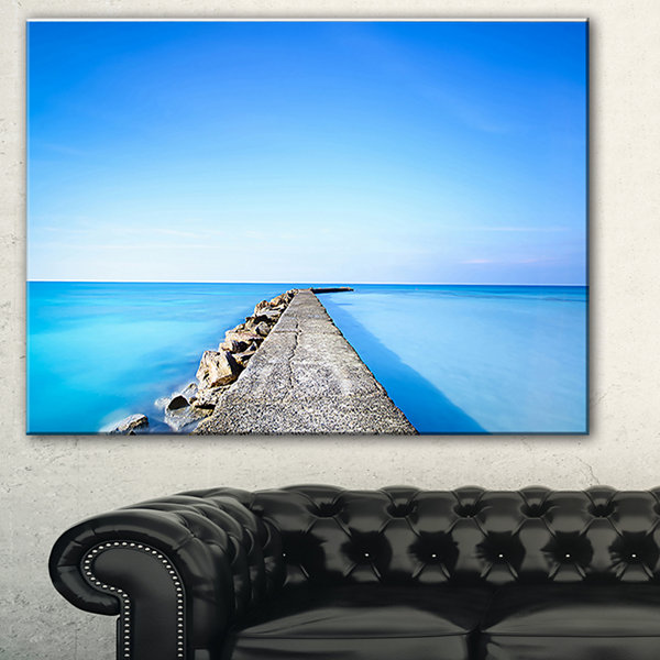 Designart Concrete And Rocks Pier Seascape CanvasArt Print
