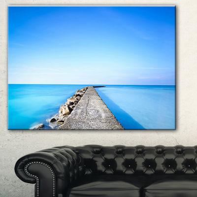 Designart Concrete And Rocks Pier Seascape CanvasArt Print - 3 Panels