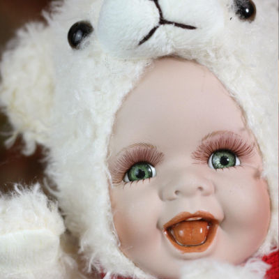 "9.25"" Porcelain Baby in Polar Bear Costume Collectible Christmas Doll"