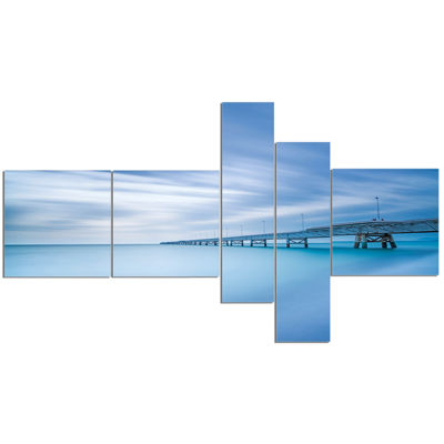 Designart Industrial Pier In The Sea Multipanel Seascape Canvas Art Print - 5 Panels