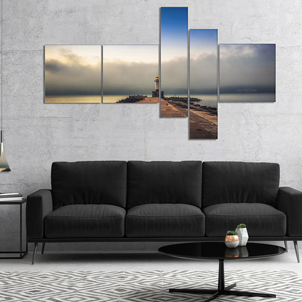 Designart Lighthouse On Coast And Cloudy Sky Multipanel Modern Canvas Art Print - 5 Panels
