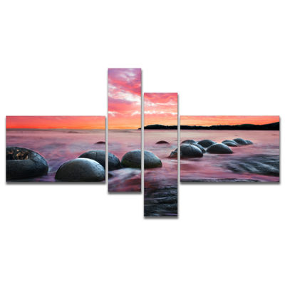 Designart Moeraki Boulders At Sunset Multipanel Seashore Photo Canvas Art Print - 4 Panels