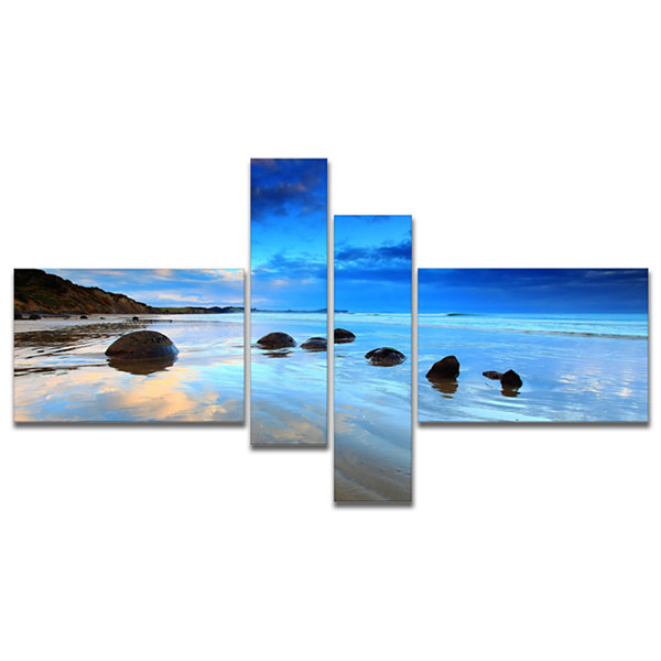 Designart Moeraki Boulders Under Cloudy Sky Multipanel Seashore Photo Canvas Print - 4 Panels