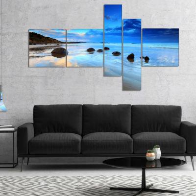 Designart Moeraki Boulders Under Cloudy Sky Multipanel Seashore Photo Canvas Print - 5 Panels