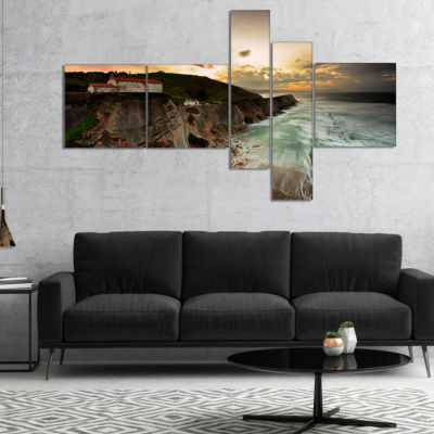 Designart Ocean Hitting Rocky Hill Multipanel Seashore Photo Canvas Art Print - 5 Panels