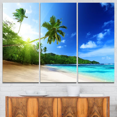 Designart Sunset Beach With Palm Landscape Photography Canvas Art Print - 3 Panels