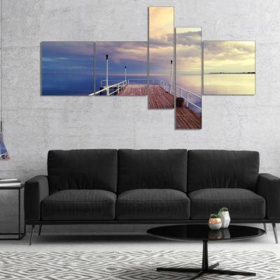 Designart Pier Under Bright Sky Multipanel Seascape Canvas Art Print - 5 Panels