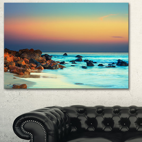 Designart Sunset Over Blue Sky Seascape Photography Canvas Art Print