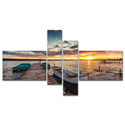 Designart Boats And Jetty Under Dramatic Sky Multipanel Modern Canvas Art Print - 4 Panels