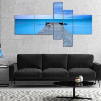 Designart Broken Concrete Jetty Multipanel Seascape Canvas Art Print - 4 Panels