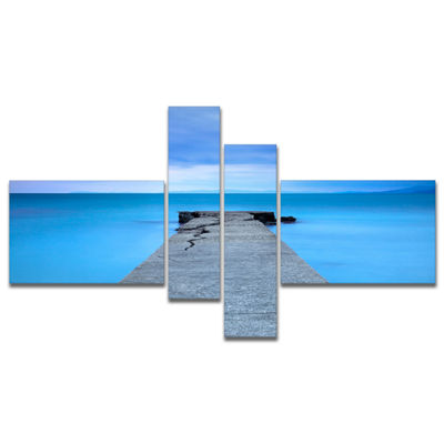 Designart Broken Concrete Jetty Multipanel Seascape Canvas Art Print - 4 Panels