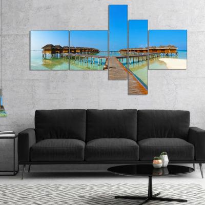 Designart Bungalows In Maldives Island MultipanelLandscape Photography Canvas Print - 5 Panels