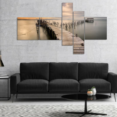 Designart Carrasqueira Old Wooden Pier MultipanelSeashore Photo Canvas Art Print - 4 Panels