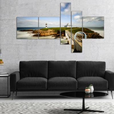 Designart Cloudy Illa Pancha Lighthouse MultipanelSeashore Photo Canvas Print - 5 Panels