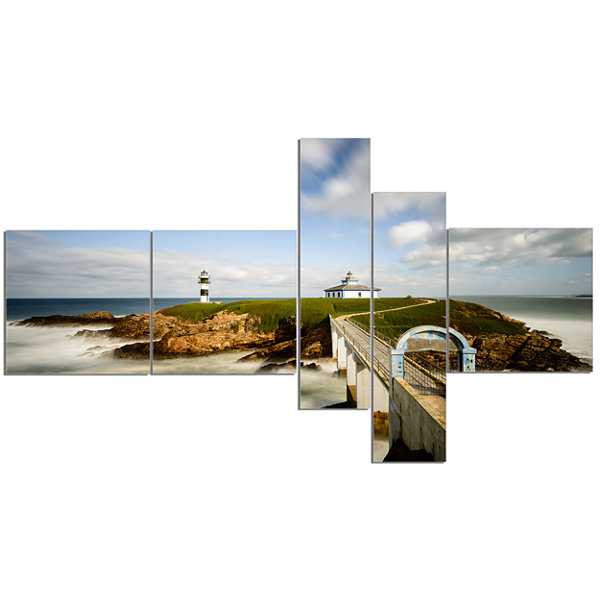 Designart Cloudy Illa Pancha Lighthouse MultipanelSeashore Photo Canvas Print - 5 Panels