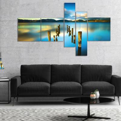 Designart Cloudy Lake With Broken Pier MultipanelSeascape Canvas Art Print - 5 Panels