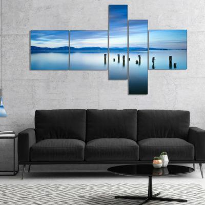 Designart Cloudy Sky In Blue Sea Multipanel Seascape Canvas Art Print - 5 Panels