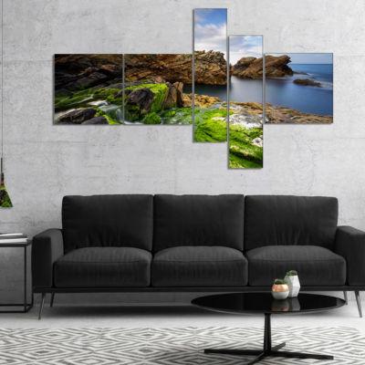 Designart Rocks And Waterfall In Spanish Coast Multipanel Seashore Photo Canvas Art Print - 5 Panels