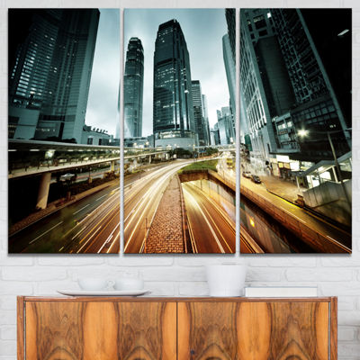 Designart Traffic In Hong Kong At Sunset CityscapePhoto Canvas Print - 3 Panels