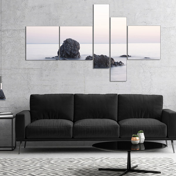 Designart Rocks In The Sea Black And White Multipanel Seashore Canvas Art Print - 4 Panels