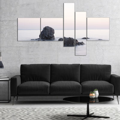 Designart Rocks In The Sea Black And White Multipanel Seashore Canvas Art Print - 5 Panels