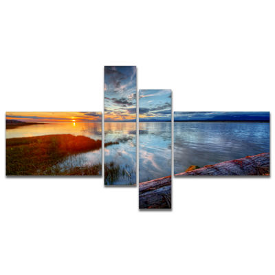 Designart Colorful River Sunset With Log Multipanel Seashore Canvas Art Print - 4 Panels