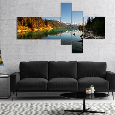 Designart Snowy Path Along Mountain Lake Multipanel Landscape Canvas Art Print - 4 Panels