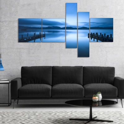 Designart Dark Blue Sea And Piers Multipanel Seascape Canvas Art Print - 5 Panels
