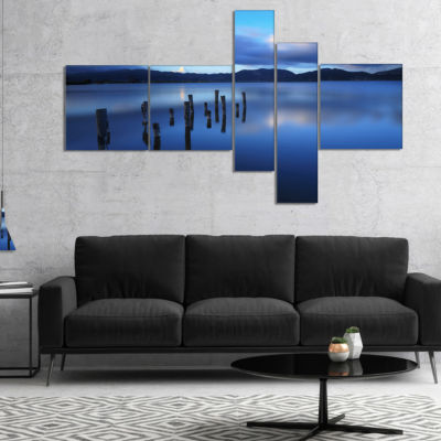 Designart Dark Blue Sea With Pier Remains Multipanel Seascape Canvas Art Print - 4 Panels