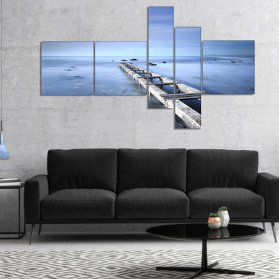 Designart Dark Blue Sky And Large Pier MultipanelSeascape Canvas Art Print - 4 Panels
