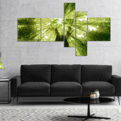 Designart Sunlight Peeking Through Green Tree Multipanel Landscape Canvas Art Print - 4 Panels