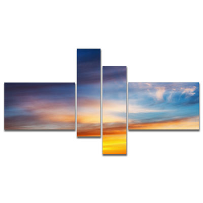 Designart Sunset Dramatic Yellow Sky Clouds Multipanel Seashore Canvas Art Print - 4 Panels