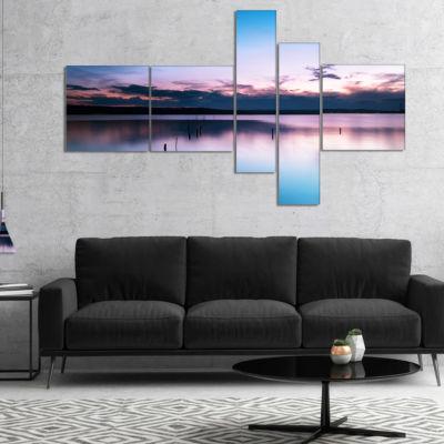 Designart Sunset Over Lake Blue Everywhere Multipanel Seashore Canvas Art Print - 4 Panels