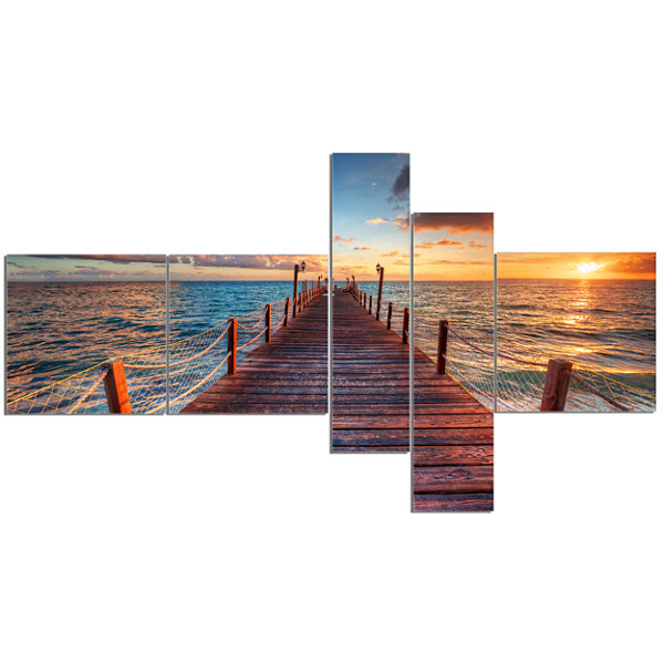 Designart Sunset Over Wooden Sea Pier MultipanelModern Canvas Art Print - 5 Panels