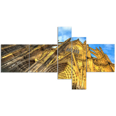 Designart Facade Of Dom Church With Blue Sky Multipanel Cityscape Art Print On Canvas - 5 Panels